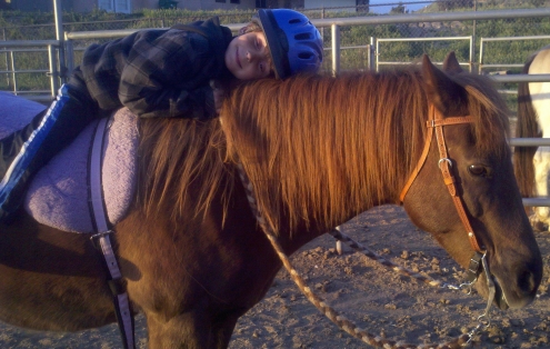riding lesson hug pony